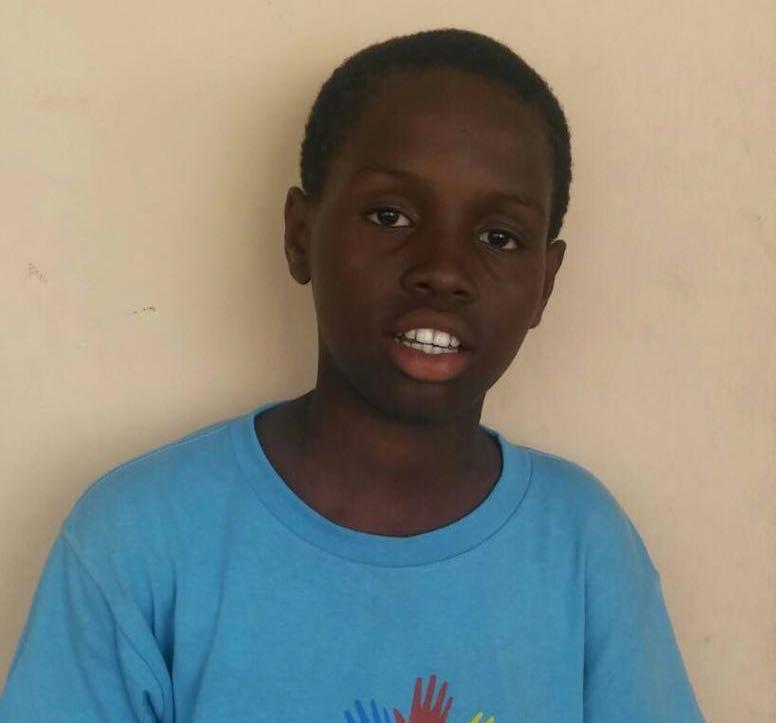 Criança assistida pela Nations Help em Porto Príncipe, Haiti
